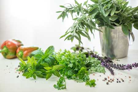 Green parsley, basil, wise, aromatic herbs and peppercorns.