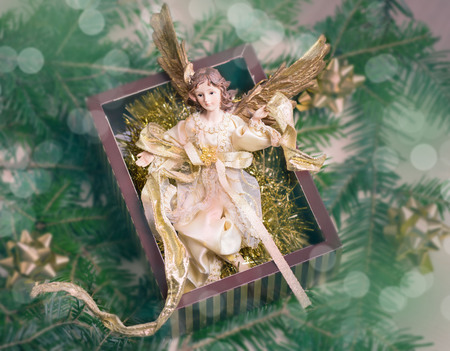 A toy angel in a gift box. A gift for a Christmas holiday. 版權商用圖片