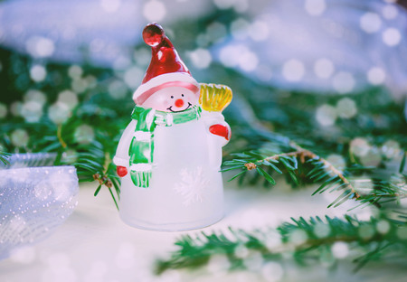 Christmas and New Year holiday background. Snowman Toy
