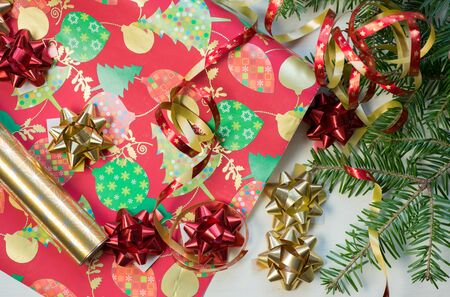 Colorful roll paper for gift wrapping and accessories. Christmas and New Year holiday.