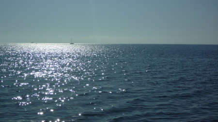 Suggestive sunshine reflections on the sea in backlight Stock Photo