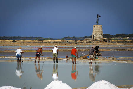 Saltworks with workers near Ronchiglio, Italy