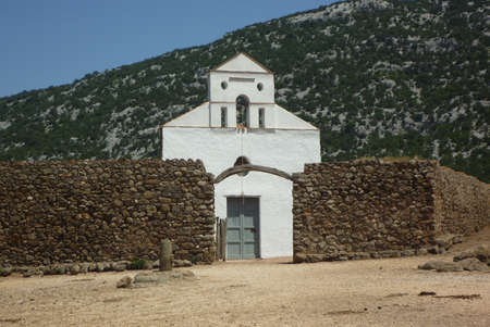 San Pietro church with stone wall close-up in Sardinia Stock Photo