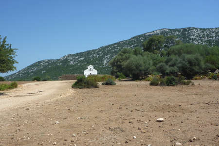 San Pietro Church on Golgo upland in Sardinia from street side Stock Photo