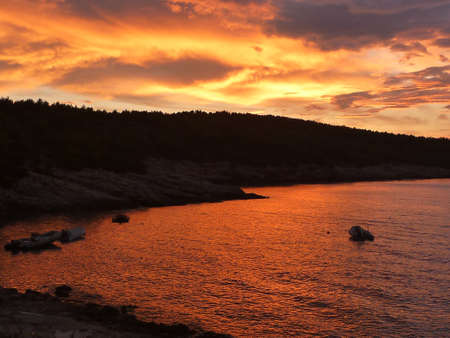 Hvar bay at sunset with amazing red colors Stock Photo