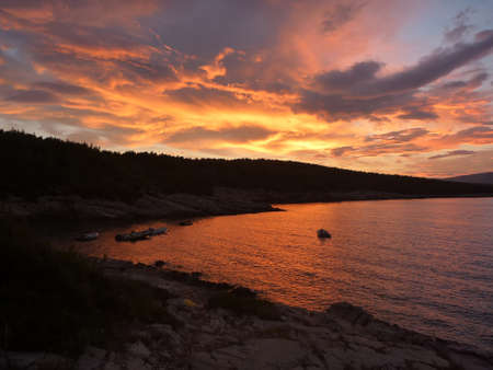 Hvar bay at sunset with amazing red and orange colours
