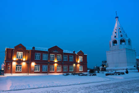 Kolomna, Moscow Region, Russia. School And Cathedral Bell Tower In Cathedral Square Kolomna Kremlin. Inscription On Brick Facade - School. Stock Photo