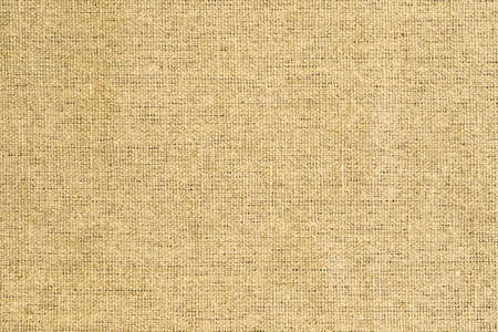 Natural Fabric Of Yellow Brown Sackcloth. Original Material. Background Texture.