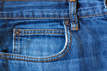 Pocket Of Blue Jeans With Seams Background Texture Close Up.