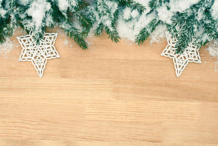 Christmas Decoration Fir Tree Branches With Snowflakes Over Wooden Table Background With Copyspace Top View.
