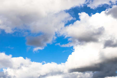 Beautiful Dramatic White Fluffy Clouds With Blue Sky.