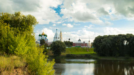 Beautiful Landscape Of Various Temples And Belltower On Assumption Cathedral Square Under Blue Sky With Dramatic Clouds By Embankment River Summer In Kolomna, Moscow Region.