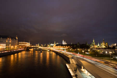 Beautiful View On Moscow Kremlin From Embankment Of Reflected Moscow River On Dramatic Sky At Autumn Night.