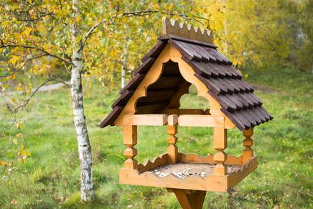 Bird Feeder. Beautiful Wooden Bird Feeder With Food In Public Park Autumn.