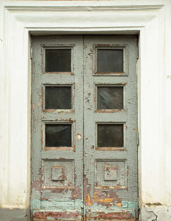 Old Wooden Classic Door With White Frame By Ancient Building House.