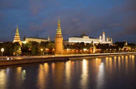 Moscow, Russia. Beautiful View Of Moscow Kremlin On Banks Of Moscow River With Reflection On Background Of Blue Hour With Clouds At Evening.