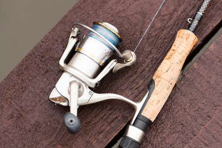 Fishing Rod On Wooden Pier On Pond On Fishing Outdoor Top View. Sport Fishing Hobby.