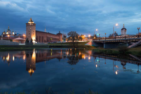 Kolomna, Moscow Region. Beautiful View: Assumption Brusensky Female Monastery, Church Of Michael Archangel And Marinkin Tower Of Kremlin With Illumination By River On Blue Hour At Autumn Evening.