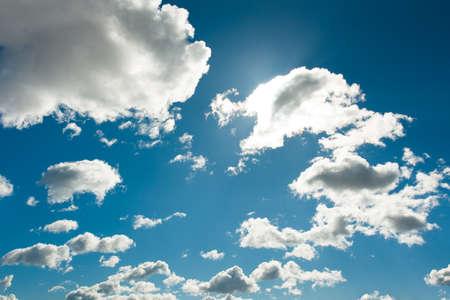 Background Bright Dramatic Fluffy White Clouds On Blue Sky Close Up. Reklamní fotografie