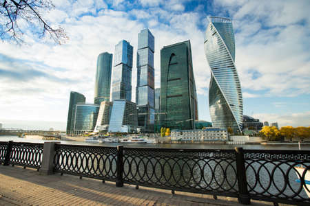 Modern Buildings Of Moscow City Complex Of Skyscrapers On Dramatic Sky Background On Embankment Of Moskva River Sunny Day At Autumn. Stock fotó