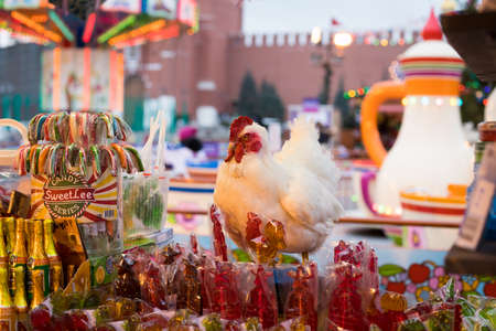 Moscow, Russia - December 21, 2017: Souvenir Cock With Different Sweets In Mini Shop On Red Square Close Up.