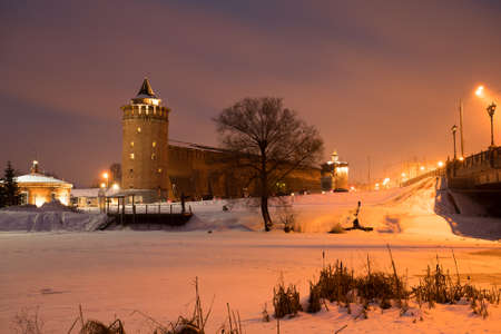 Beautiful View Landmark: Marinkin Tower Of Kremlin With Illumination From Lamp On Blue Sky With Clouds At Winter Evening In Kolomna, Moscow Region.