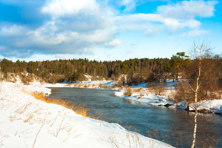 Beautiful Scenic Landscape View In Russia Of River Under Dramatic Sky With Clouds In Sunny Day In Winter. Woods Forest On Riverside.