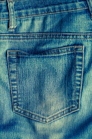 Jeans. Close Up Old Blue Jeans With Pocket With Seams Texture Background.