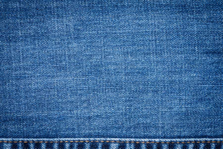 Texture Jeans. Close Up Of Blue Jeans Fabric Macro With External Seams Yellow.