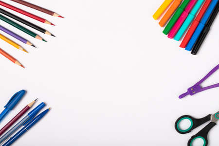 Close Up School Or Office Stationery Accessories On Background Of White Paper With Copyspace For Text Top View.