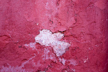 Abstract Texture Background Of Concrete Wall With Obsolete Paint Red Color.
