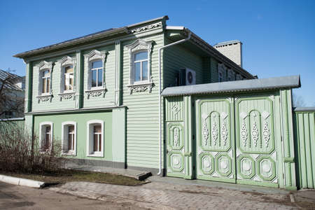 Kolomna, Russia. Beautiful Green Wooden House In Kolomna Kremlin Under Blue Sky In Sunny Day In Spring.