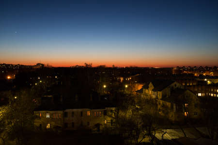 Beautiful Landscape With Residential Buildings, With Light From Street Lamps And Lamps In Houses On Red-Blue Background Of Evening Sky In Spring In City Of Kolomna, Russia. Imagens