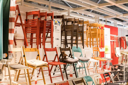 Moscow, Russia - March 25, 2018: Sample Of Interior Of Modern Design Of Variety Colorful Folding Chairs Display On Shelf In Shop IKEA. 新聞圖片