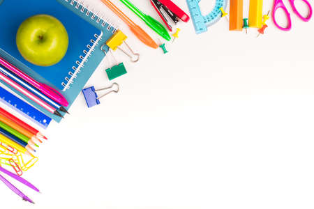 School Or Office Stationery With Green Fresh Apple On White Background Of Table With Copyspace Top View. Stok Fotoğraf - 131657978