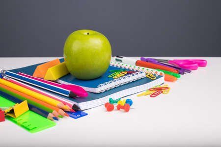 Different School Or Office Stationery On White Table Copyspace.