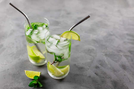 Two refreshing mojito cocktails with eco-friendly cocktails and ice. Summer drinks