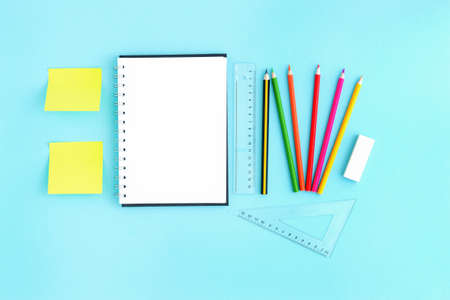 Blank open notebook with blank sheets and around stationery and colour pencils ruler. Space for text, office work during quarantine and virus Banque d'images