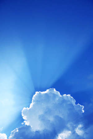 Rays of light in blue sky. photo
