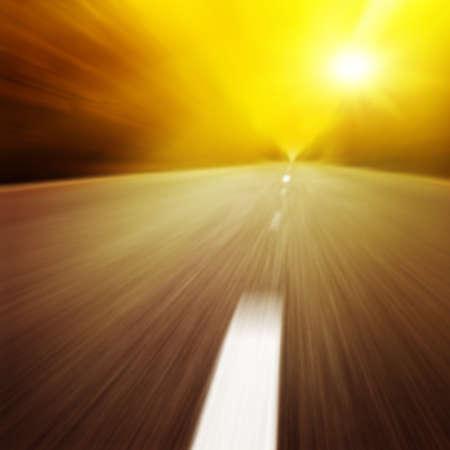Motion blurred road at twilight. photo