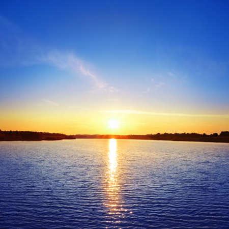 sunrise beach: Sunset over lake.  Stock Photo