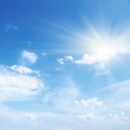 sky: Blue sky with clouds and sun.  Stock Photo