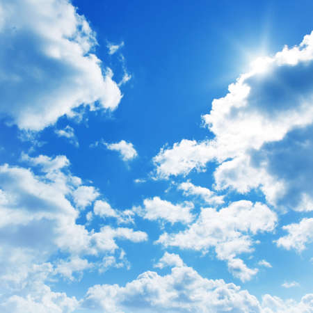 high day: Blue sky with clouds and sun.  Stock Photo