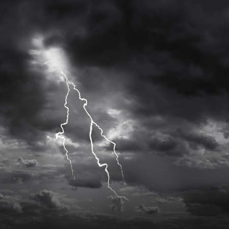 thunderstorm: Lightning strike and dark moody sky. Stock Photo