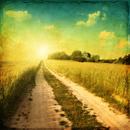 Retro image of country road at sunset  photo