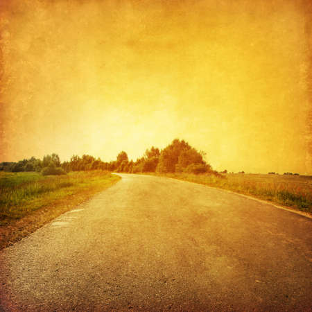 tar paper: Road at sunset in grunge and retro style   Stock Photo