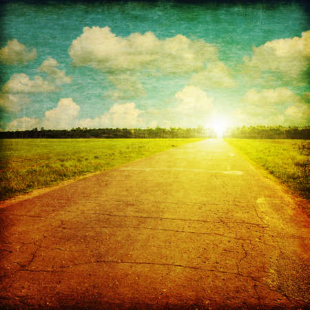 Rural road at sunset in grunge and retro style  photo