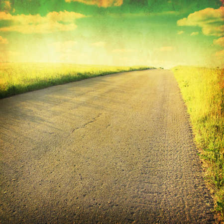 tar paper: Rural road through the field in grunge and retro style.