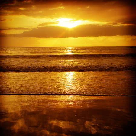 beach sunset: Sun setting over the ocean