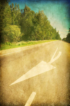 non marking: Country road with arrow sign in grunge and retro style